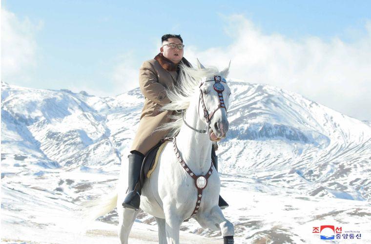 North Korean leader Kim Jong-un rides white horse through snowfall on Paektu Mountain